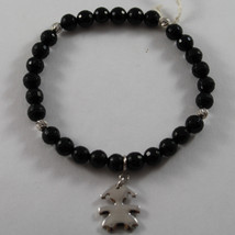 .925 RHODIUM SILVER ELASTIC BRACELET WITH BLACK ONYX AND CHARM WITH GIRL