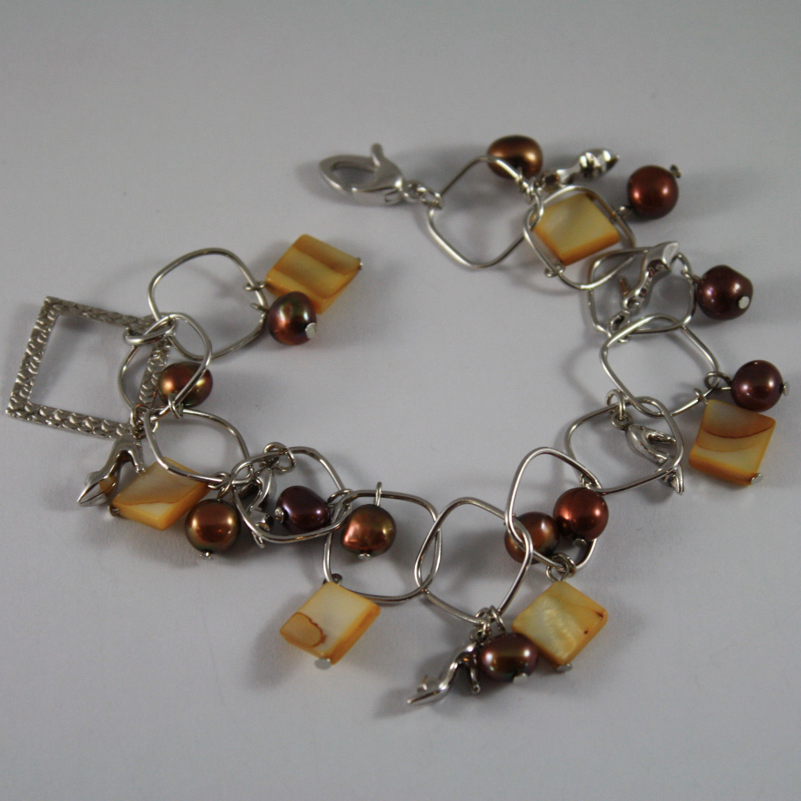 .925 RHODIUM SILVER BRACELET WITH BROWN PEARLS, MOTHER OF PEARL AND SHOES CHARMS