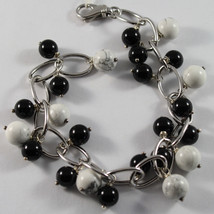 .925 RHODIUM SILVER BRACELET WITH BLACK ONYX AND WHITE HOWLITE
