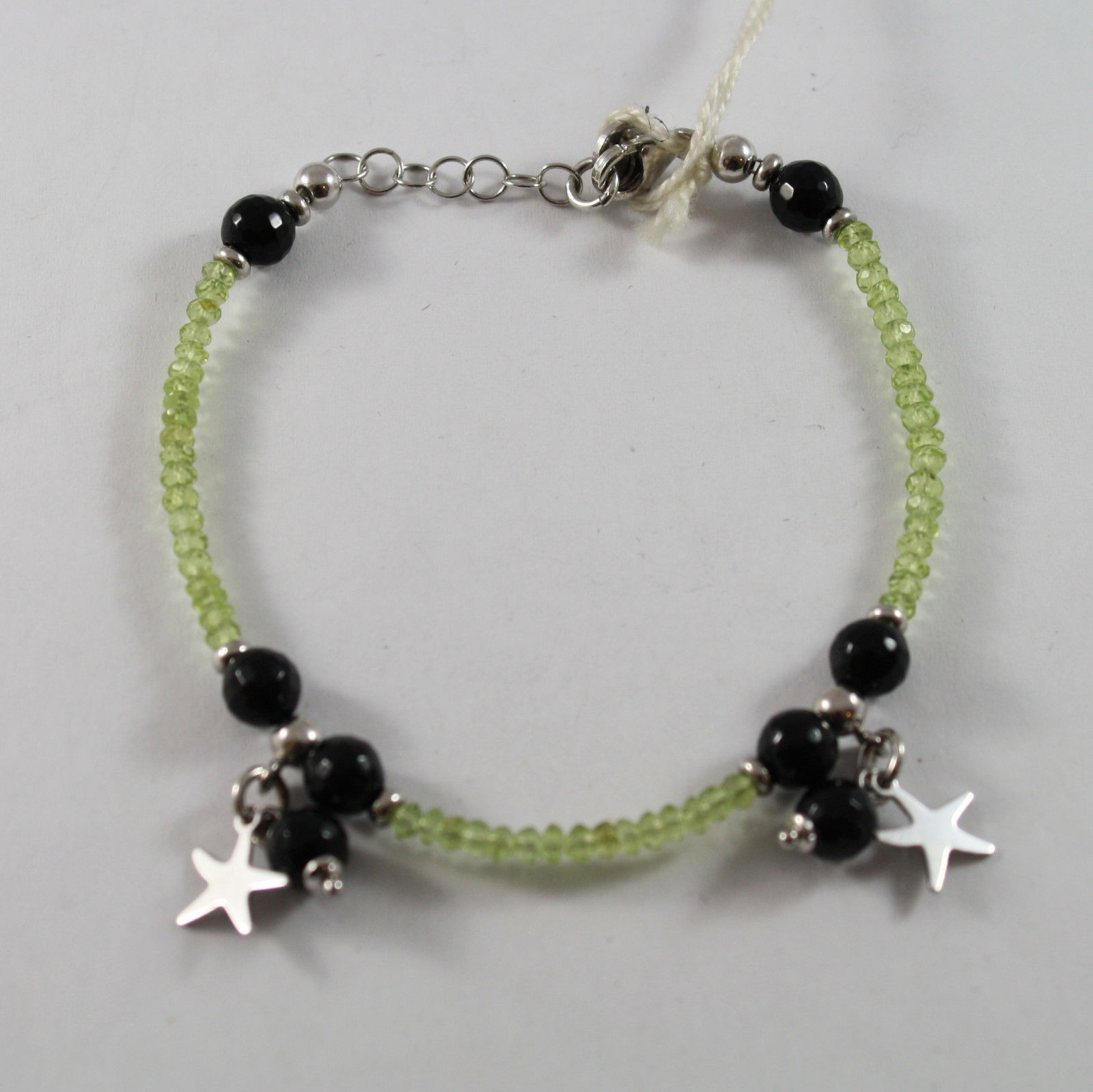 .925 RHODIUM SILVER BRACELET WITH GREEN PERIDOT, BLACK ONYX AND STARS