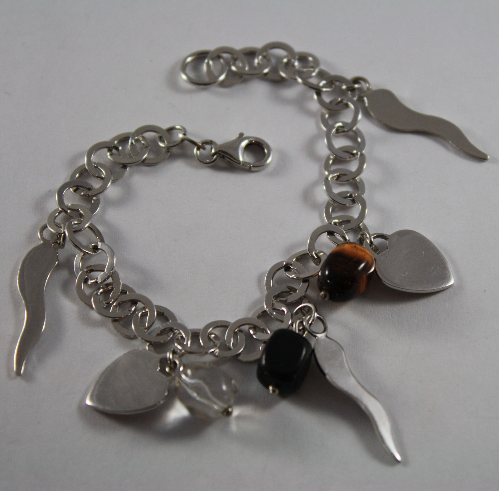 .925 RHODIUM SILVER BRACELET WITH TIGER'S EYE, BLACK ONYX , CRISTAL AND CHARMS