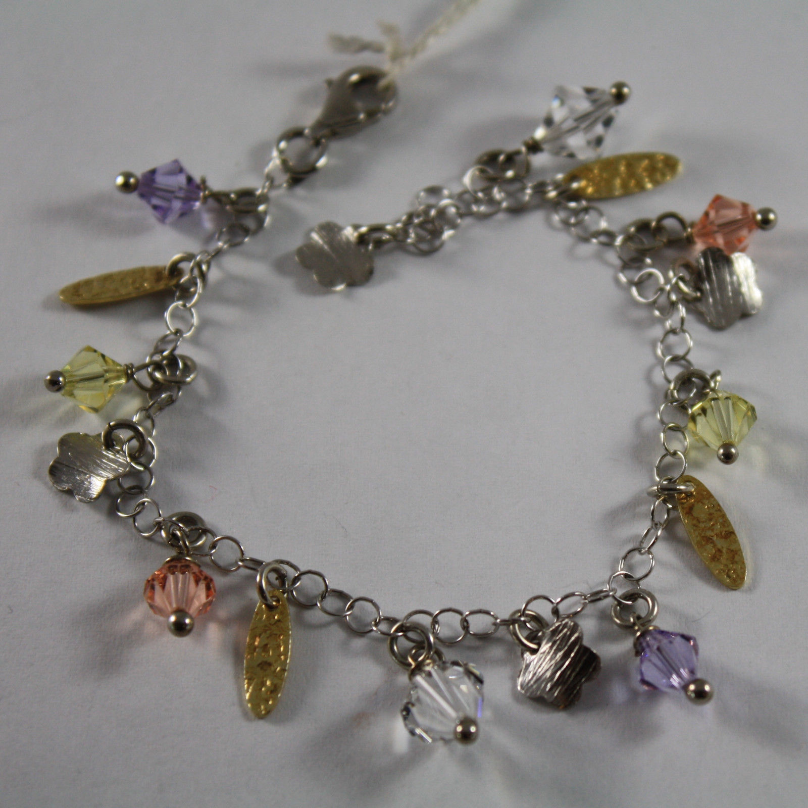 .925 RHODIUM SILVER AND YELLOW GOLD PLATED BRACELET WITH CRISTAL AND CHARMS