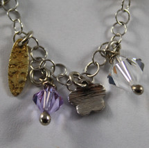 .925 RHODIUM SILVER AND YELLOW GOLD PLATED BRACELET WITH CRISTAL AND CHARMS image 2