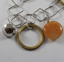 .925 RHODIUM SILVER BRACELET WITH GOLD CIRCLE, ORANGE JADE AND SILVER SPHERE image 2