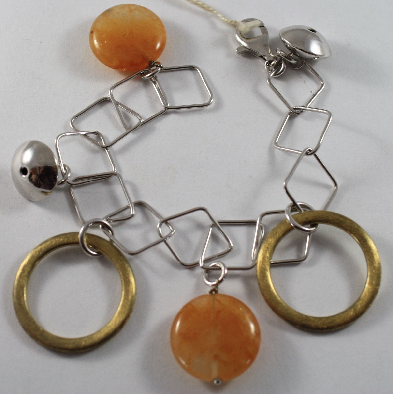 .925 RHODIUM SILVER BRACELET WITH GOLD CIRCLE, ORANGE JADE AND SILVER SPHERE