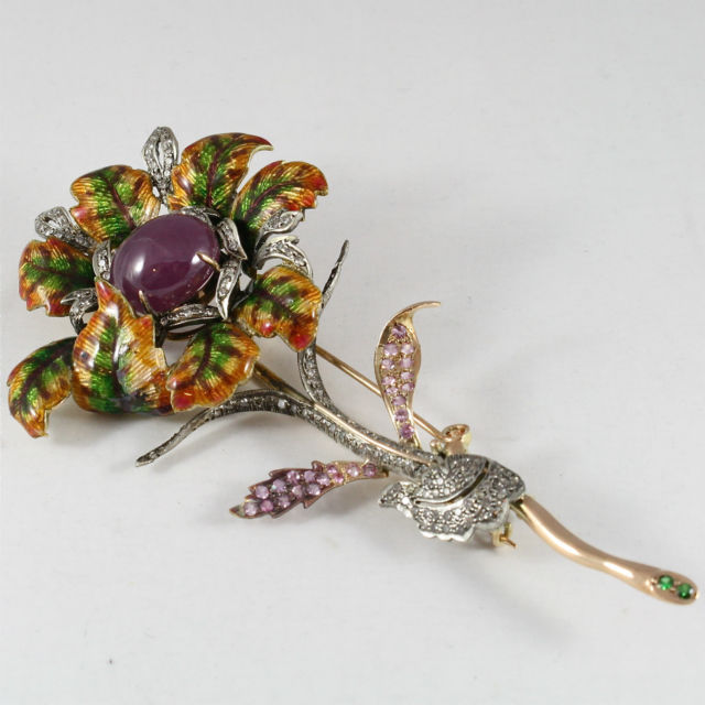 18K GOLD FLOWER BROOCH WITH DIAMONDS, CABOCHON RUBY, EMERALD SAPPHIRES AND GLAZE