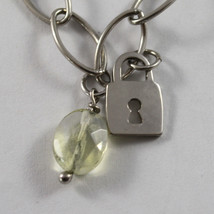 .925 RHODIUM SILVER BRACELET WITH QUARTZ CITRINE AND CHARMS OF KEYS AND LOCKS image 1