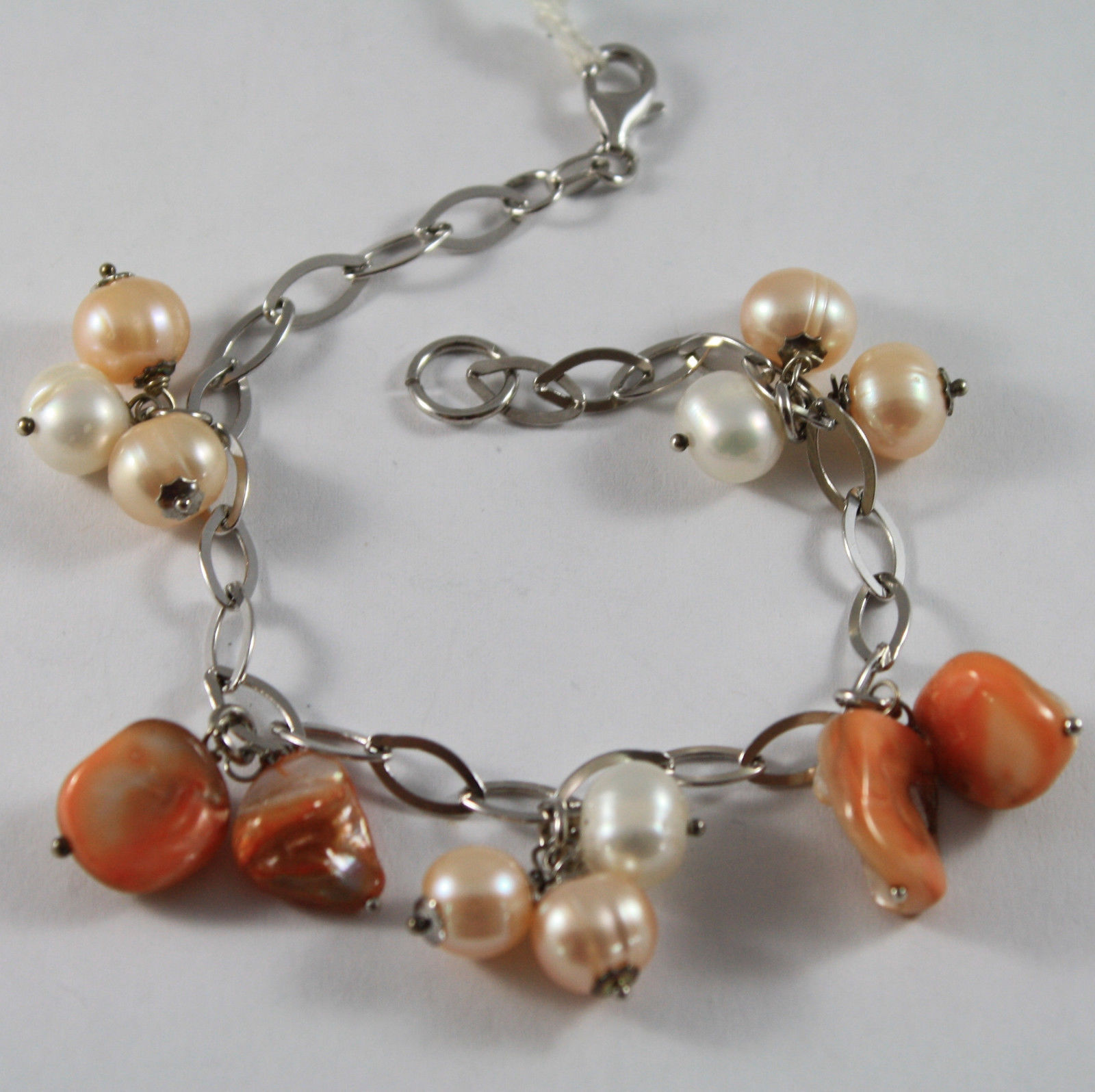 .925 RHODIUM SILVER BRACELET WITH ORANGE MOTHER OF PEARL AND ROSE & WHITE PEARLS