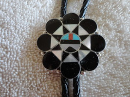 SOUTHWESTERN SUN FIGURE BOLO WITH LEATHER AND STERLING TIPS - $123.49