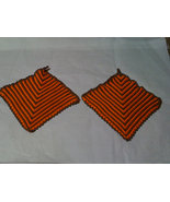 Hand crocheted orange/brown potholder set. - $8.00