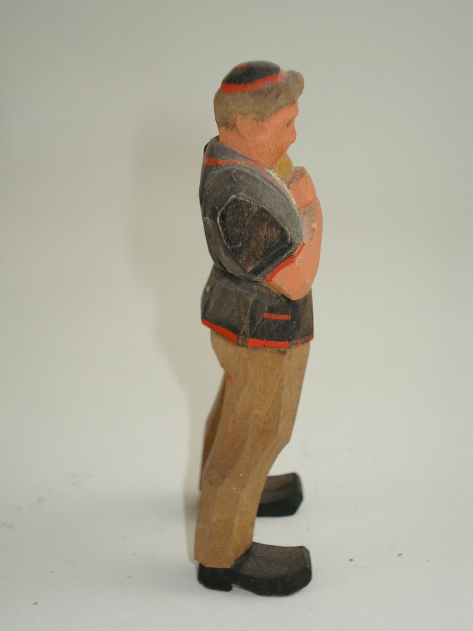 hand carved tiny man-possible Anri