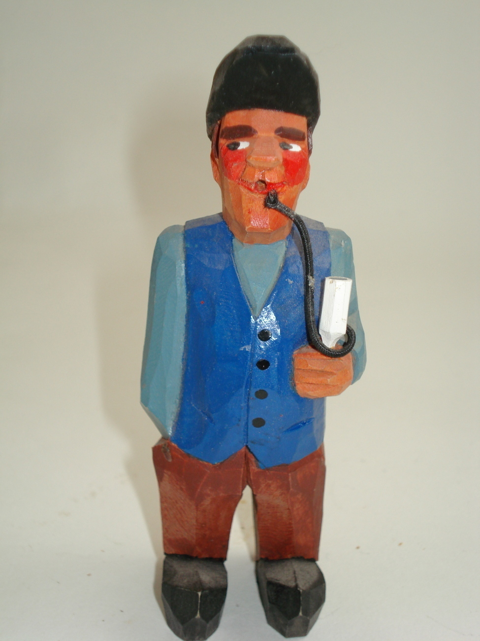 hand carved man smoking pipe-possible Anri