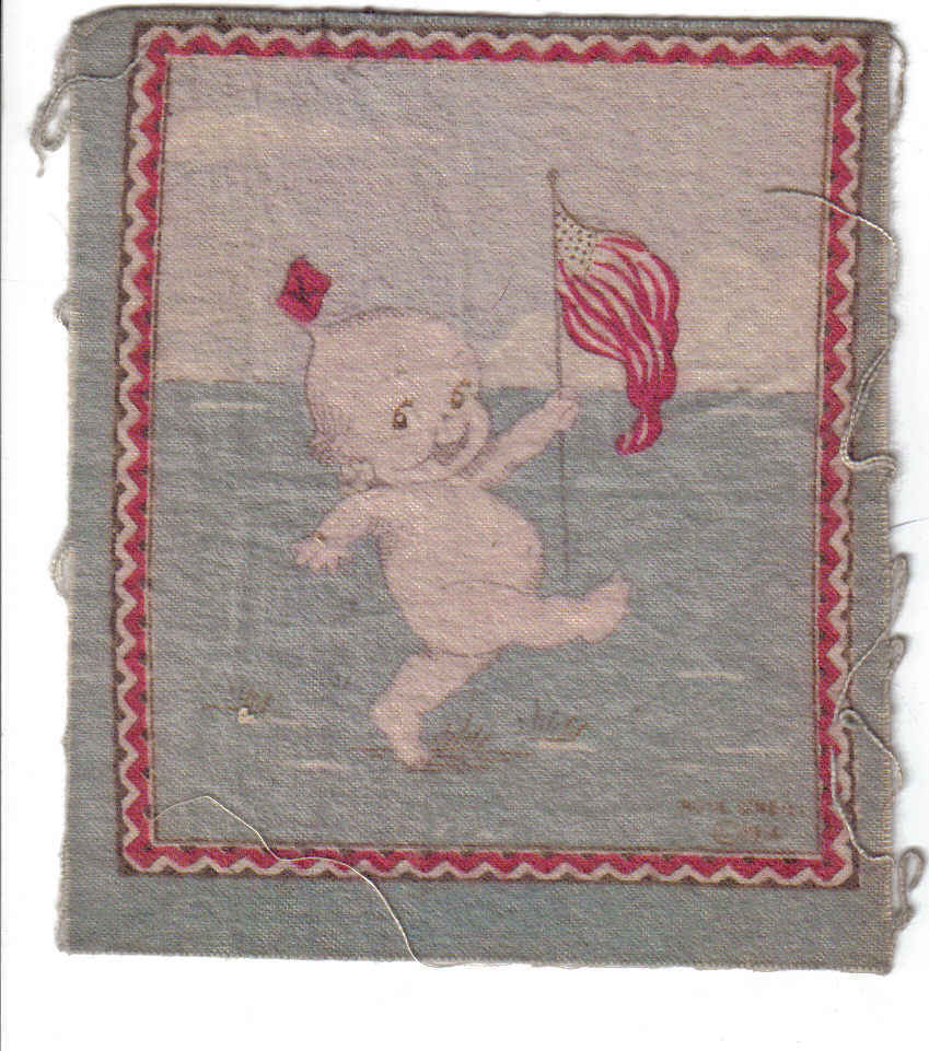 Good kewpie with flag