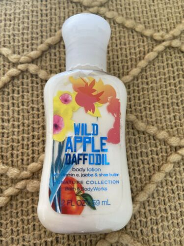 Primary image for Bath and Body Work Wild Apple Daffodil  Body Lotion 2 oz, NEW!!!!  (Discontin