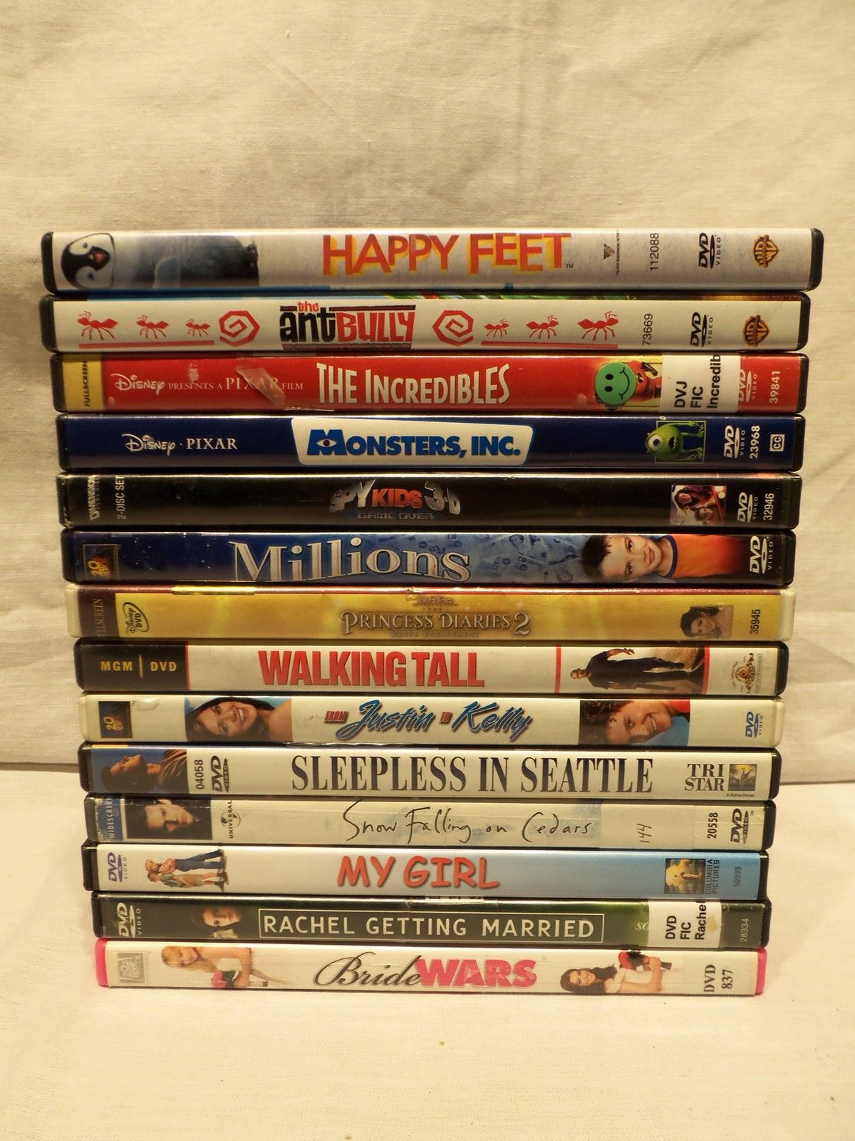 Primary image for Lot of 14 General DVDs Disney Monsters Incredibles Happy Feet Sleepless  Seattle