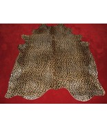 Leopard Print Cowhide rug on Caramel Background - $325.71