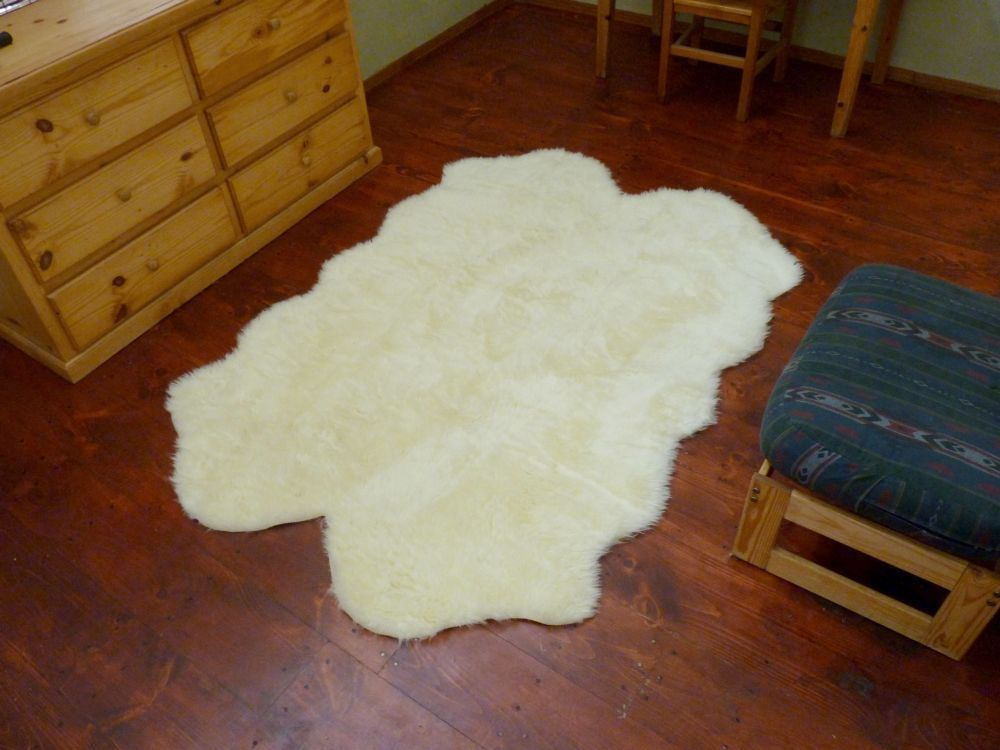 "6'6"" x 4' 6"" Faux Fur Quad Sheepskin Pelt Rug Ivory - Non Skid Backing"