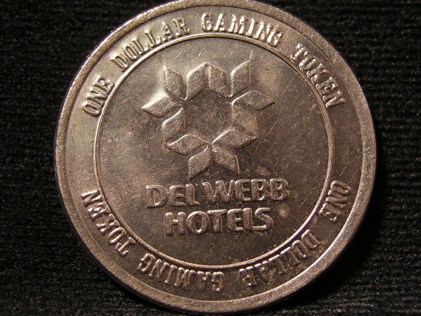 "$1.00 CASINO SLOT TOKEN FROM: ""DEL WEBB'S SAHARA HOTEL & CASINO"" - (sku#2312)"