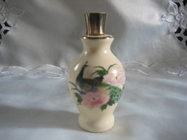 Perfume bottle with peacock design - $11.00