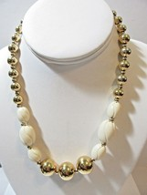 Bright Gold Tone Beaded Necklace With Carved Beige Lucite Oval Beads N API Er - $12.00