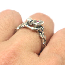 Silver Skull Holding Flower Rose Ring  - $92.00