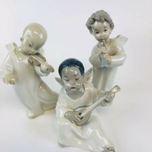 3 Lladro Black, Chinese & Angel With Flute Figurines  Retired - $173.25