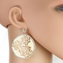 UNITED ELEGANCE Rose Tone Cut-Out Earrings Engulfed by Swarovski Style Crystals - $24.99