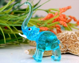 Vintage hand blown glass elephant figurine blue trunk up tusks mini thumb200