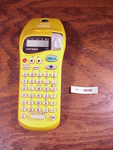Yellow Dymo Letra Tag Label Maker with installed Black on White Cartridge - $17.02 CAD
