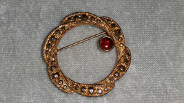 Wreath intertwined gold tone garnet gold tone pin brooch vintage timeless - $15.00
