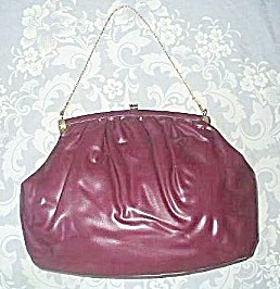 Purple vinyl handbag one