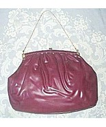 Purple vinyl handbag one thumbtall