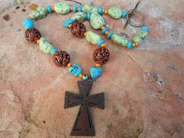 Rusty Cross Pendant on a UniqueHandmade  Beaded Necklace - $35.00