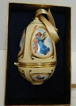 2006 Mr. Christmas Musical Egg Ornament Angel Carrying Child Valerie Parr Hill - $18.32