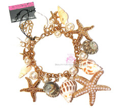 Beauty for Ashes Sea Shell Charms Faux Pearl Gold Starfish Bracelet Lobs... - $17.95