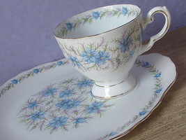 Vintage Tuscan love in the mist blue white bone china tea cup and snack ... - $38.61