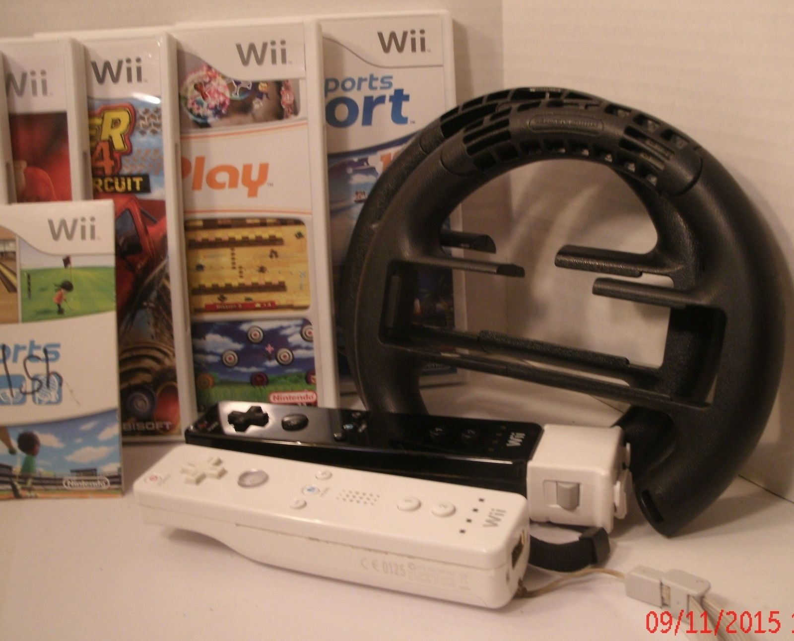 2006 Nintendo Wii Console Controlers Nunchuk Steering Wheel 7 Games Gently Used