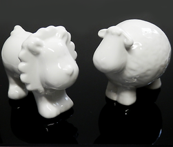 "Two White Porcelain Figurines Lion and Sheep 3"" Tall  - $15.00"