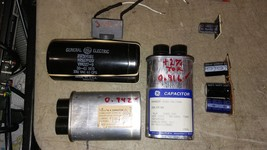 7HH81 ASSORTED CAPACITORS: 2100V/ 0.91MF, 2300V/ 0.90MF, 330V/ 38MF, 250... - $22.77
