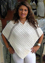 white Poncho from  - $64.00