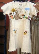 White baby dress from  - $38.00