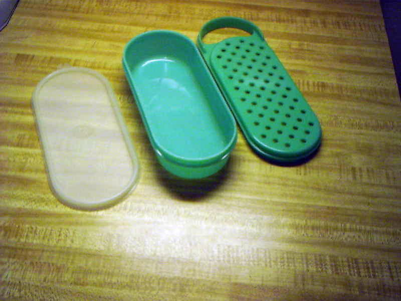 Primary image for Tupperware oval grater for taco cheese, parmesean cheese, chocolate shavings etc