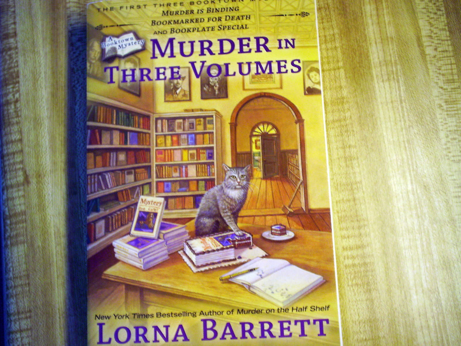 Primary image for Murder in Three Volumes by Lorna Barrett (2012, Paperback) a Booktown Mystery