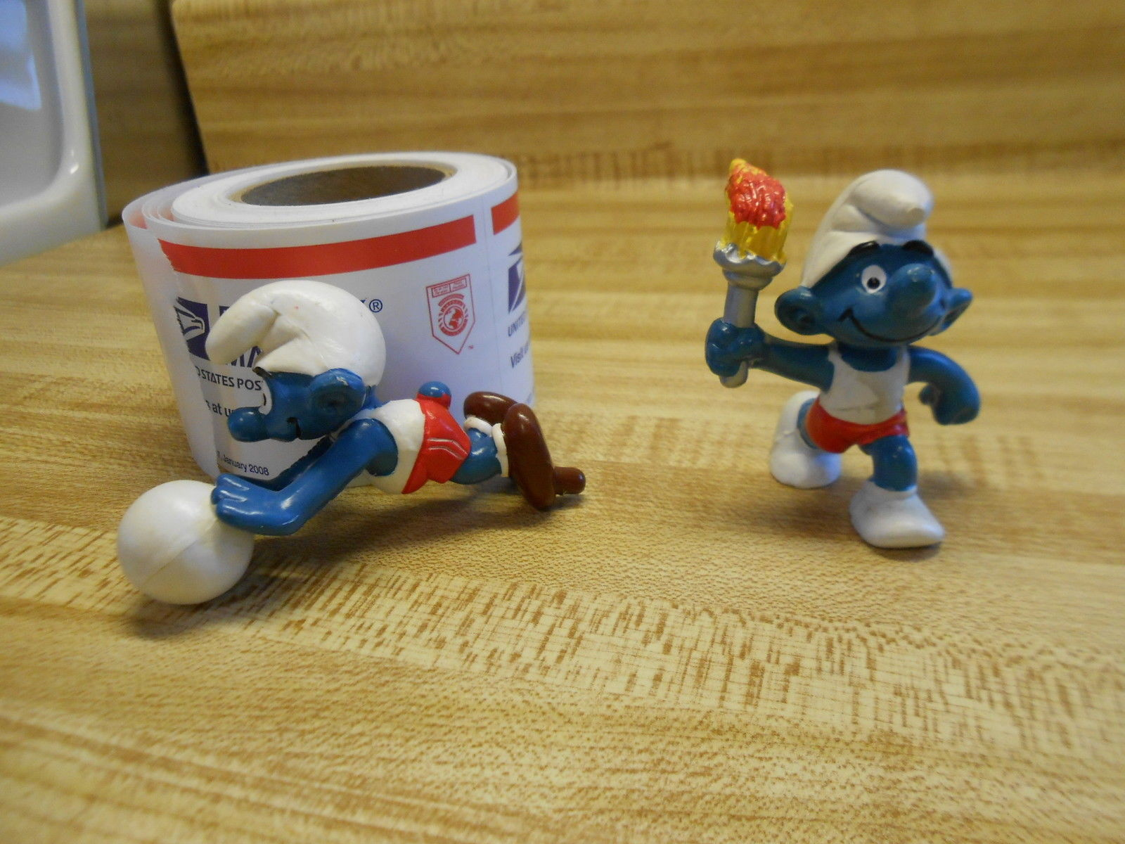 Primary image for smurf figurines set of 2 one carries the olympic torch one plays volleyball 1978