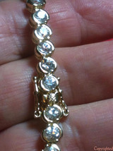 Bracelet SPARKLES Clear Round Stones .925 Sterling Silver with YG Plating - $61.00