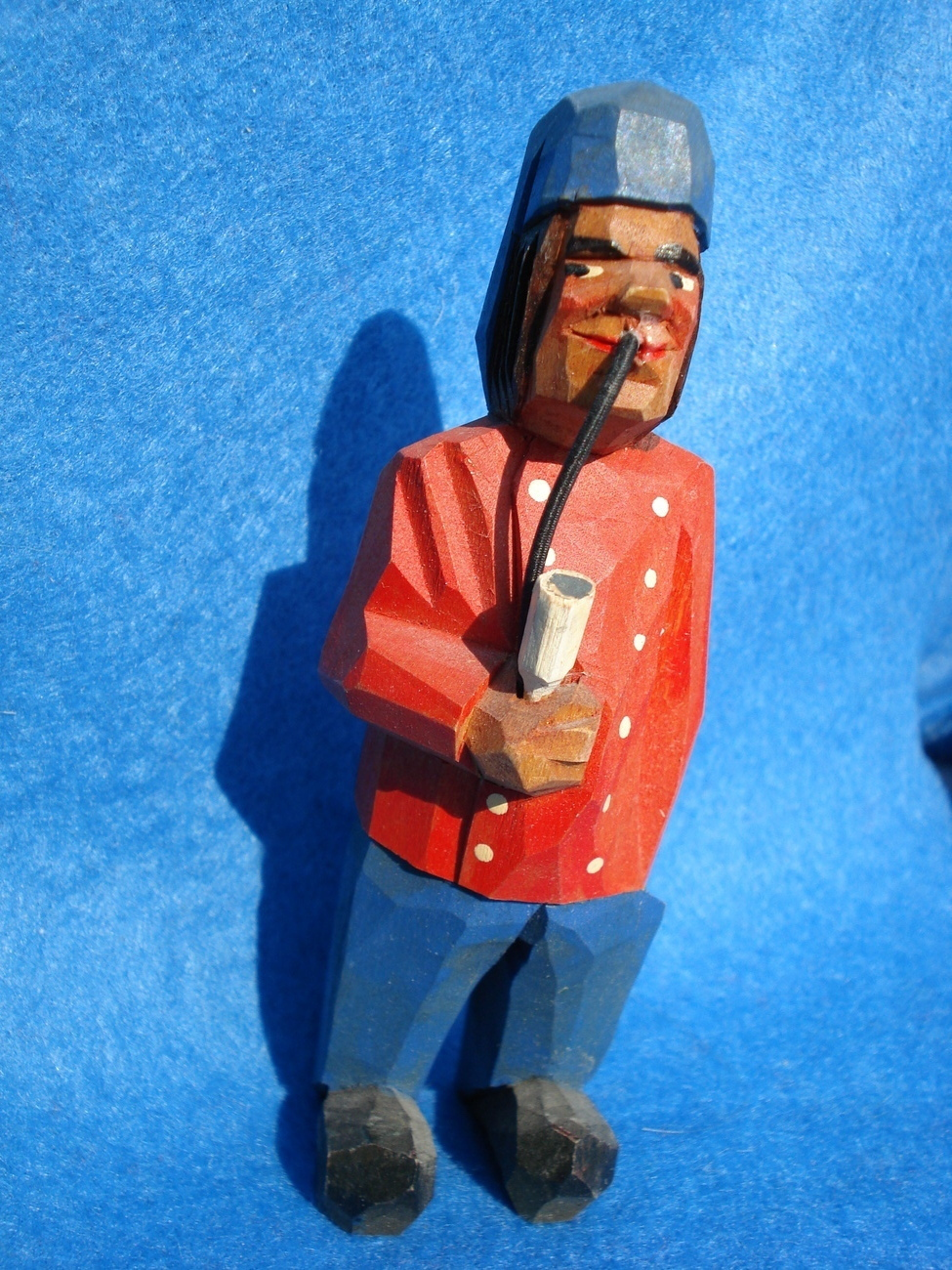hand carved tiny wood man red jacket smoking pipe-Anri ???