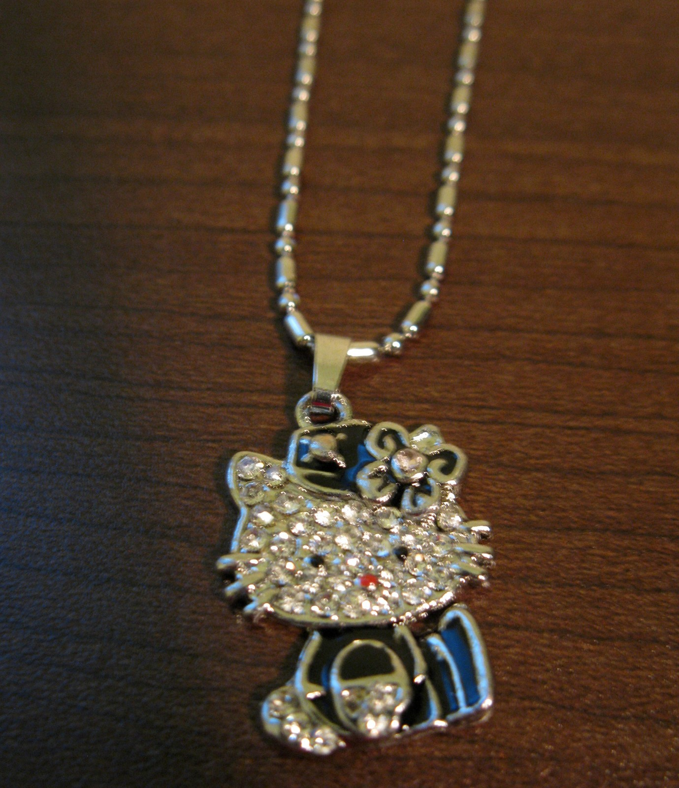 D596 hello kitty blue dress necklace
