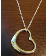 Sizzling Silver Sliding Heart Necklace & Pendan... - $10.99