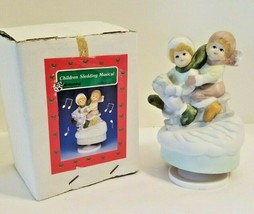 Vintage 1980s Bisque Children Sledding w/ Christmas Tree Revolving Music... - $5.82
