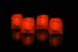 Set of 4 Litecubes Jewel Color Tinted Amber Orange Light up LED Ice Cubes - $11.54 CAD